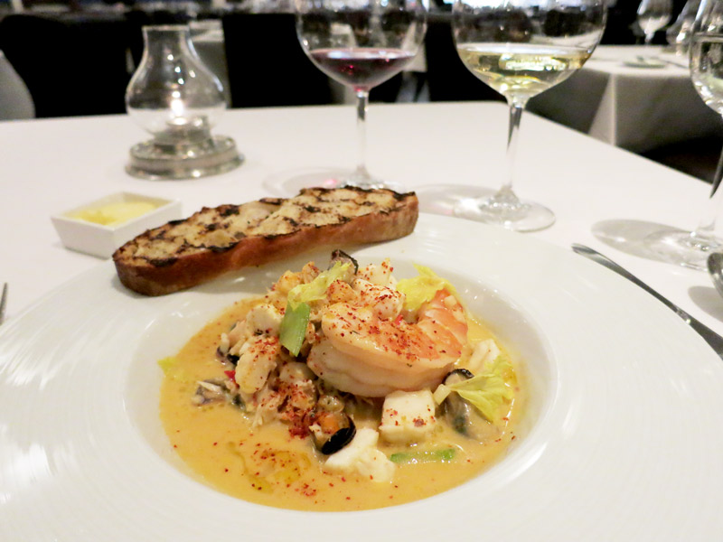 Provençal seafood stew full of lobster, crab, mussels, clams, shrimp and halibut at The St. Regis Aspen's Chefs Club