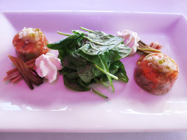 Tender pork knuckle in aspic with spinach, savory whipped cream and pickled spring onion at UFO