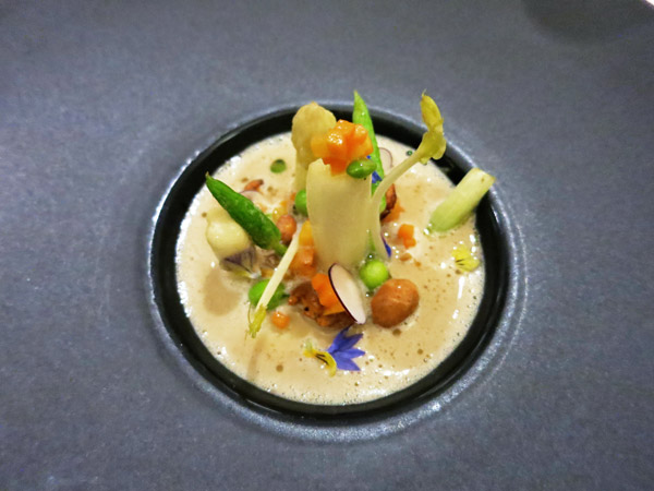 Cream of chanterelle soup with wild asparagus at Tian in Vienna
