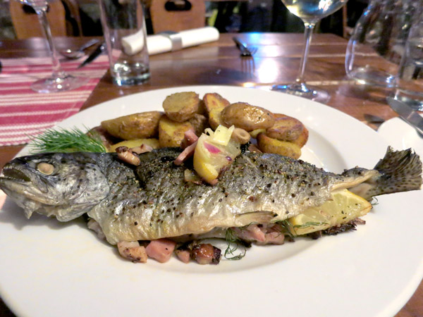 Fresh trout stuffed with bacon and mushrooms accompanied by roasted potatoes at Modrá Hviezda