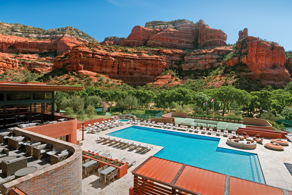 View of the red rock canyons behind the pool at the Enchantment Resort in Sedona, Arizona