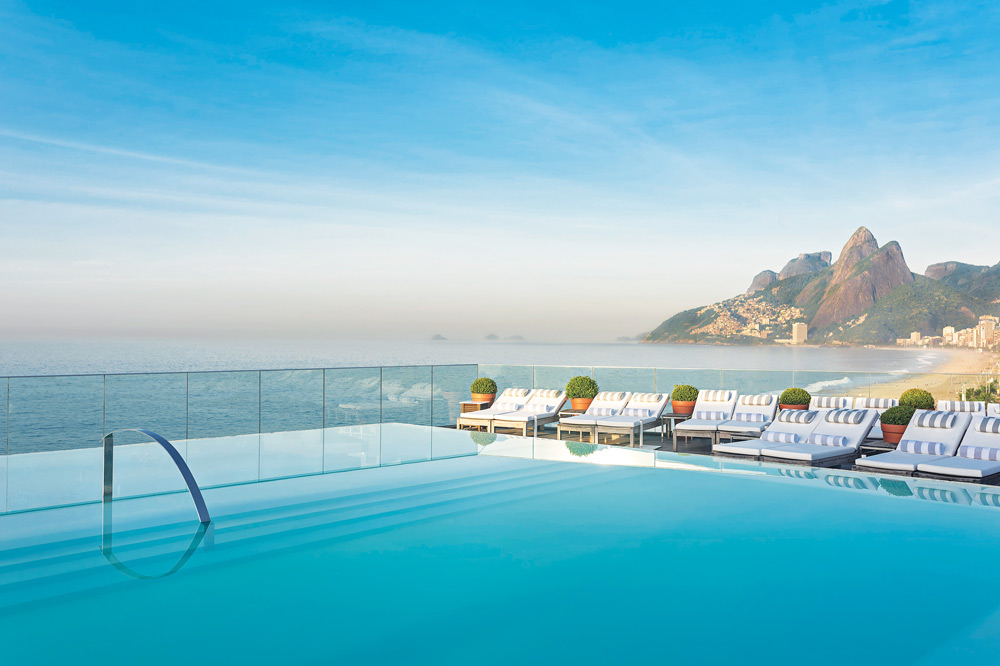 View from the pool overlooking both the sands of Ipanema beach and the Dos Hermanos at Hotel Fasano, Rio de Janeiro