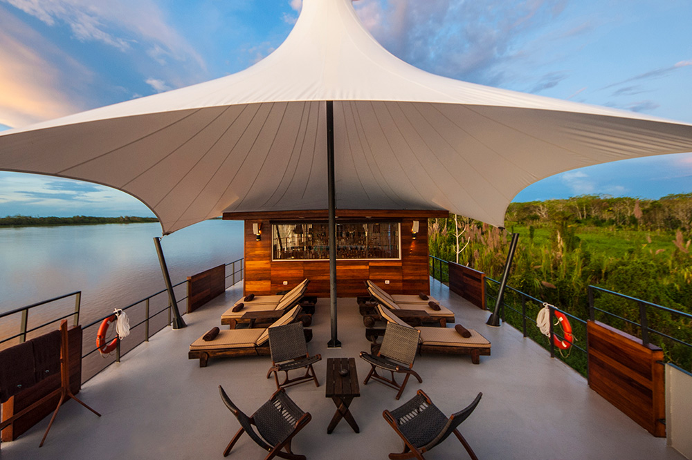 The outdoor lounge on the <em>Aria Amazon</em> by Aqua Expeditions - Aqua Expeditions