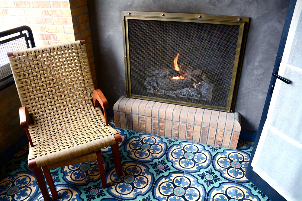 The outdoor gas fireplace off our Terrace Room at Hotel Emma - Photo by Hideaway Report editor