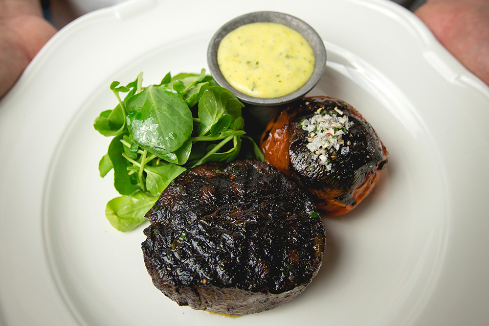 The filet mignon, served with roasted tomato, béarnaise and watercress, from <em>Bavette's</em>