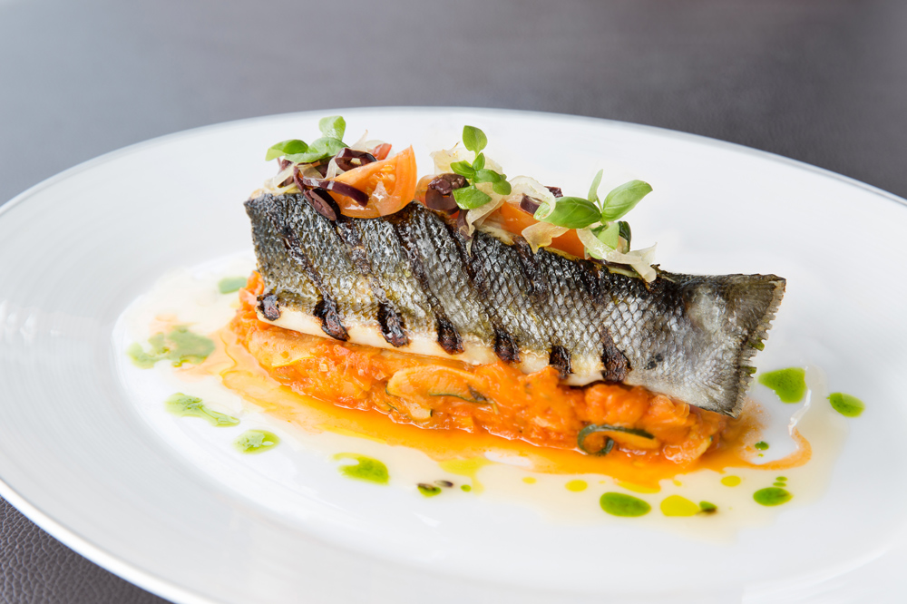 Charred sea bass with lavender verjus at <em>Café Gray Deluxe</em>