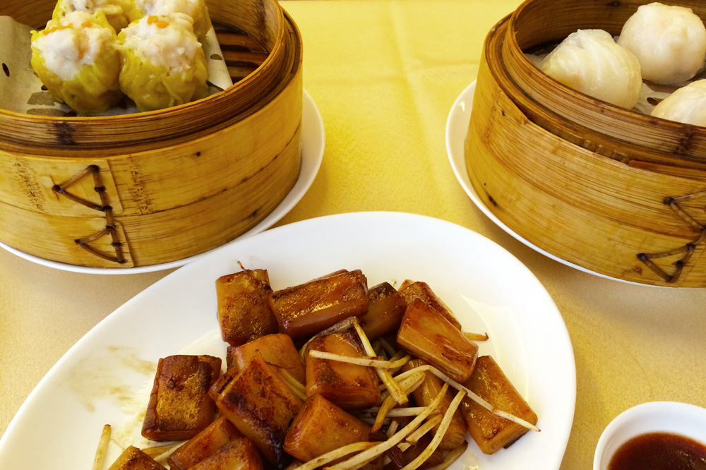 Steamed shrimp dumplings, steamed pork dumplings and pan-fried rice rolls in spicy XO sauce at <em>Tim's Kitchen</em>