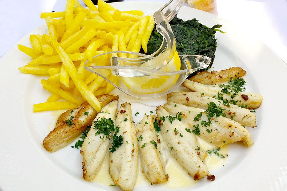 Perch fillets, frites, and Fondant wine at <em>Café du Centre</em>