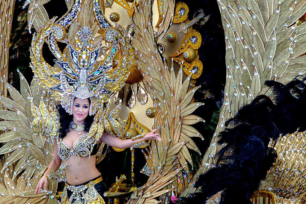A woman in a lavish costume at Carnival in Santa Cruz de Tenerife on the Canary Islands, Spain