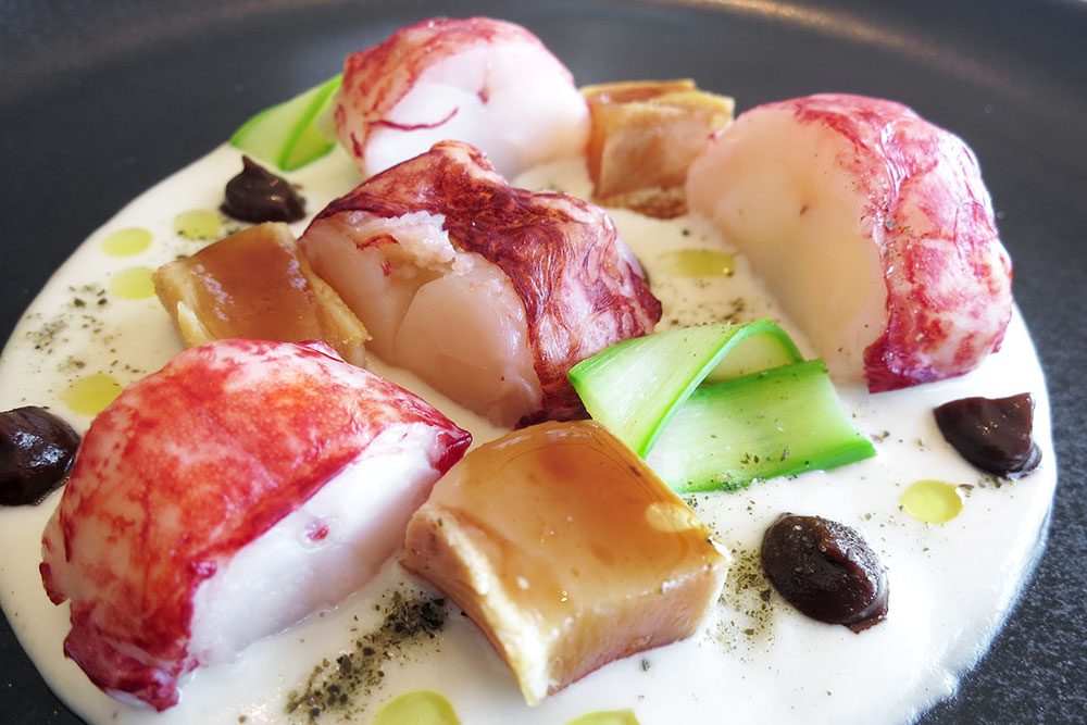 Lobster with slow-cooked chicken and black garlic at<em> Casa Solla</em>
