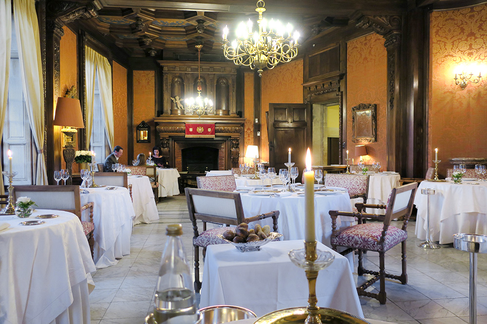 The Louis XIII salon, home to the castle's Michelin-starred restaurant, at the Château de la Treyne in Lacave, France - Photo by Hideaway Report editor