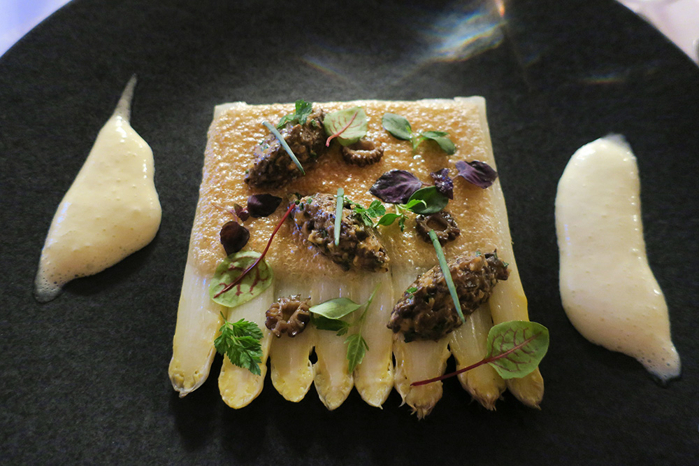 White asparagus with walnut crust, morel duxelle and lemon sabayon in the Louis XIII salon at the Château de la Treyne in Lacave, France - Photo by Hideaway Report editor
