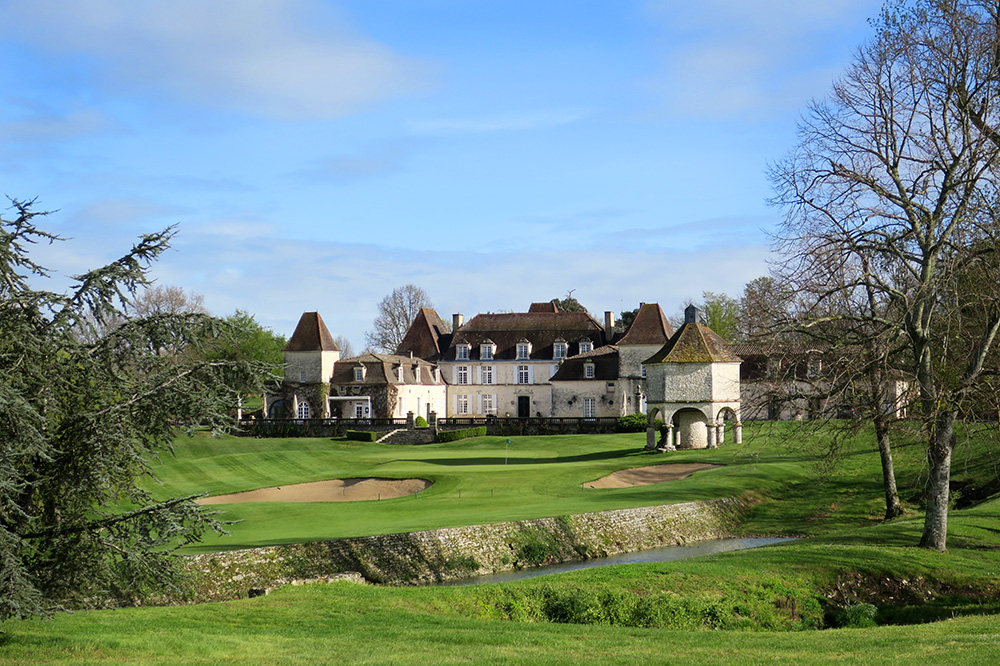The golf course and exterior of the Château des Vigiers in Monestier, France
