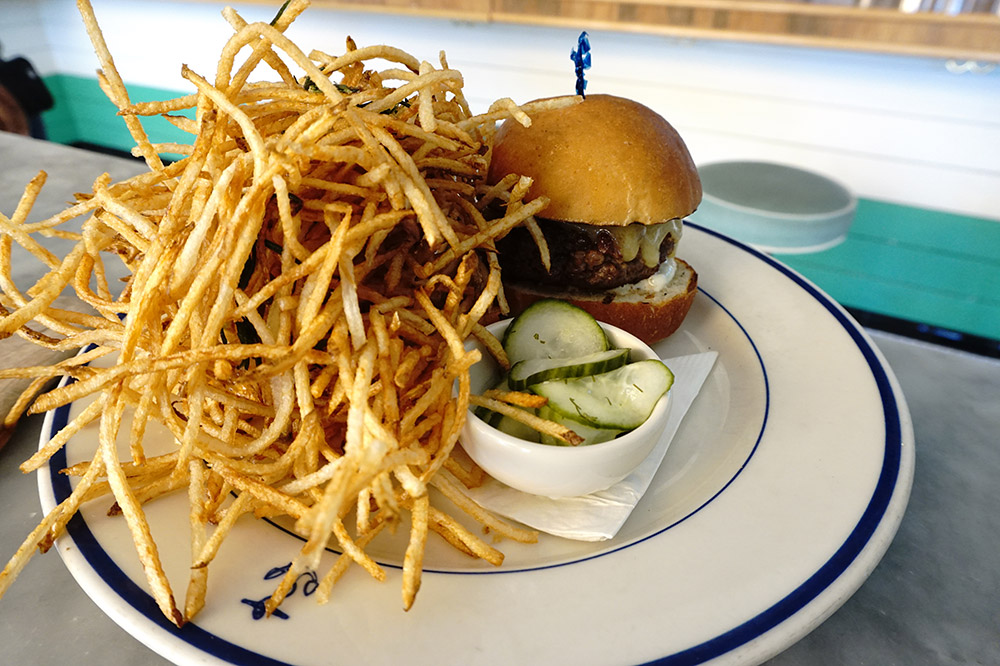 The black Angus hamburger with sauce gribiche, Gruyère and fries tossed with rosemary from <em>Clark's Oyster Bar</em>