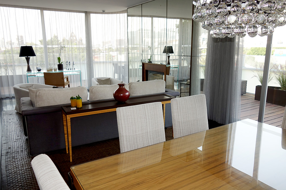 The living room and dining table of our Corner Suite at Las Alcobas