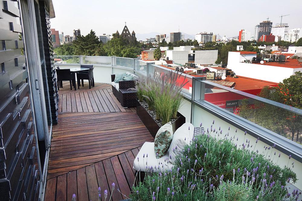 The wraparound balcony of our Corner Suite at Las Alcobas