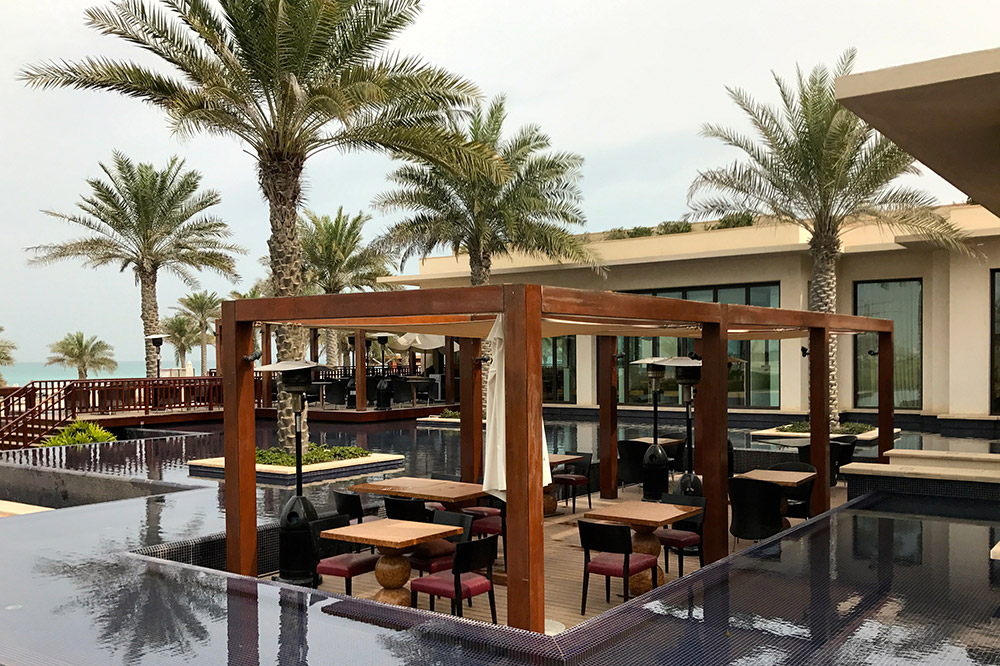 An outdoor dining area, St. Regis Saadiyat Island Resort - Photo by The Ryokan Collection