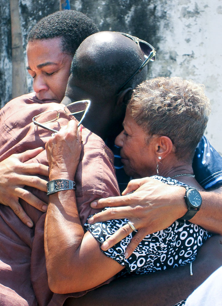Don Lemon and his mother, Katherine, embrace historian Essel Blankson, who brought them through the Cape Coast Castle in Cape Coast, Ghana. The Cape Coast Castle was a main exit point for slaves going to the United States.