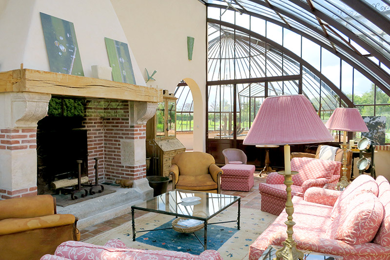 Lounge in the conservatory at La Borde - Photo by Hideaway Report editor
