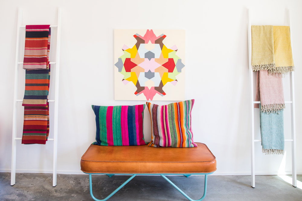 Upholstered leather bench with textiles at Garza Marfa