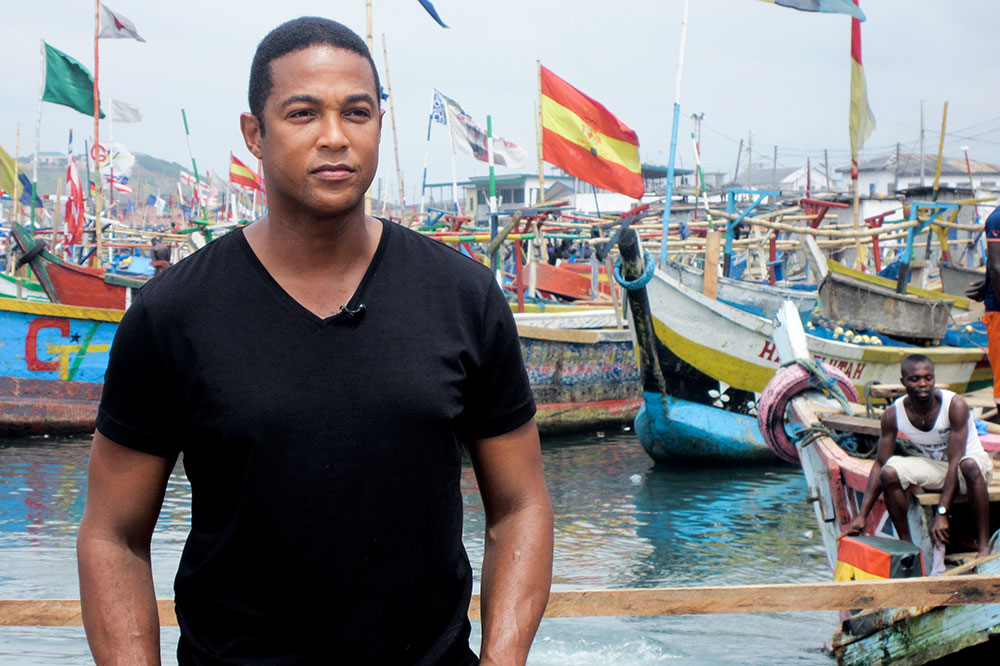 Don Lemon in front of the colorful fishing port of Cape Coast, Ghana. Lemon and his mother, Katherine, went to Ghana to explore the history of their ancestors.