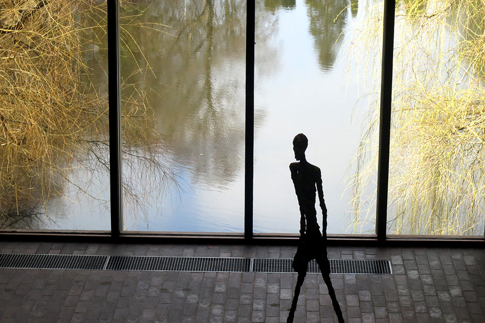 """The Walking Man"" by Alberto Giacometti on display at the Louisiana Museum of Modern Art in Humlebæk, Denmark - Photo by Hideaway Report editor"