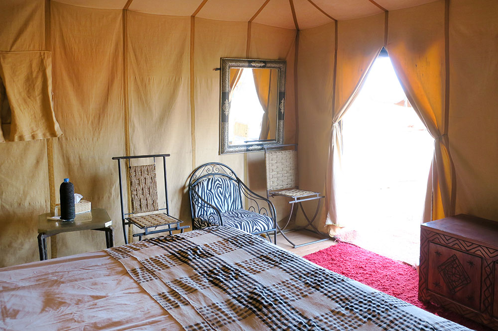 The interior of our guest tent at Merzouga Luxury Desert Camps in Merzouga, Morocco