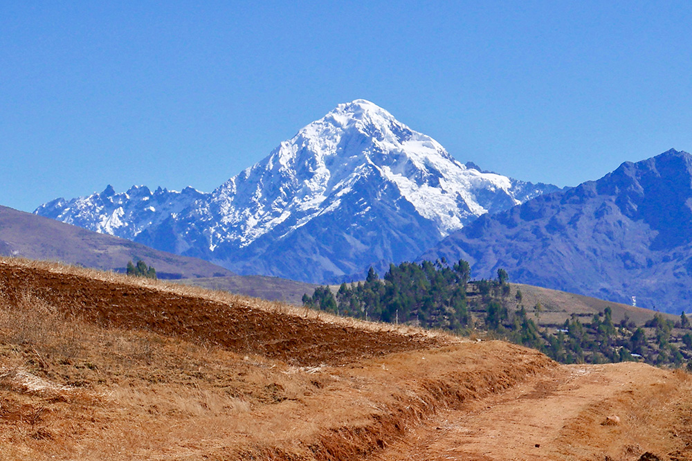 A hiking trail and the summit of Veronica (19,394 feet) overlooking the Sacred Valley, Peru - Photo by Hideaway Report editor