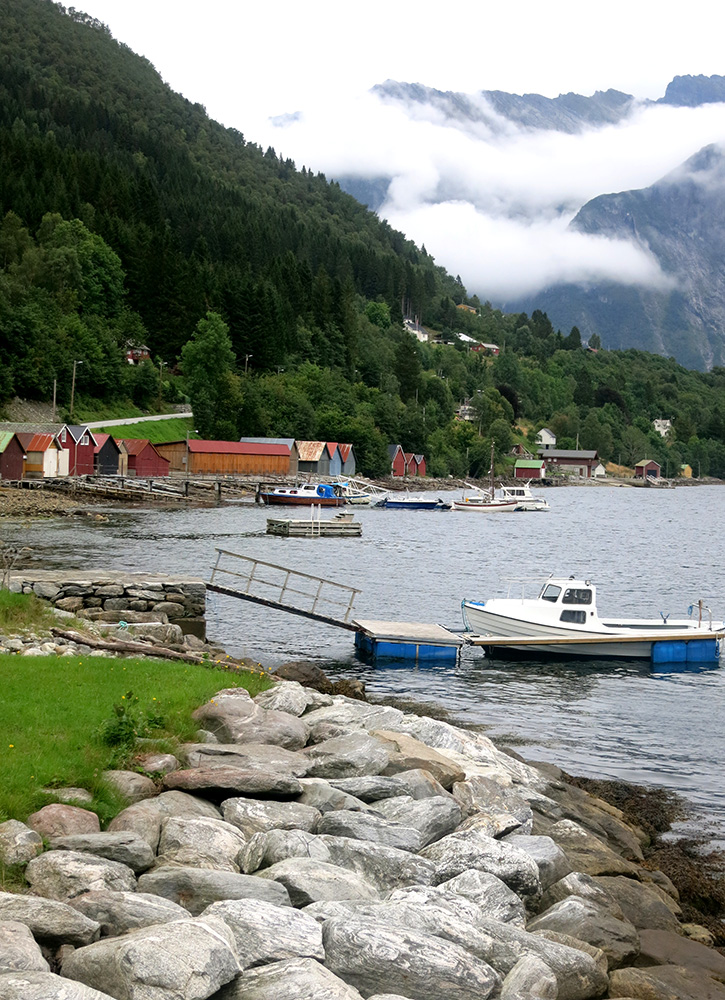 The boat docks, boathouses and mountains in this picture capture Norway in a single shot.