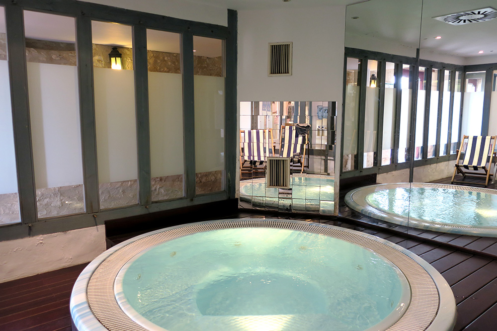 The spa's hot tub at Château des Vigiers in Monestier, France