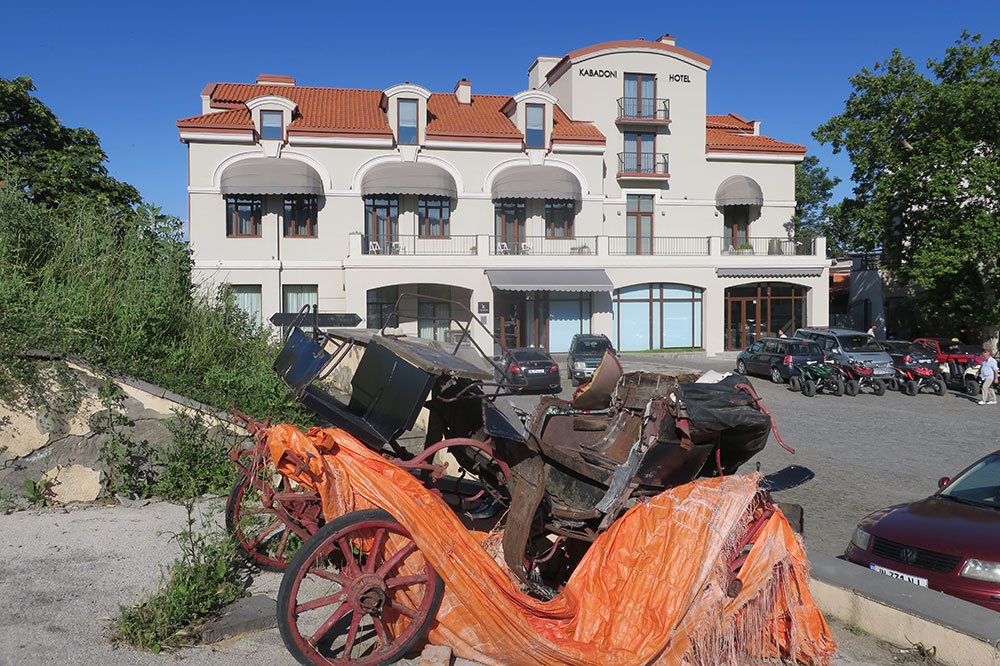 An old broken-down carriage outside of Hotel Kabadoni in Sighnaghi