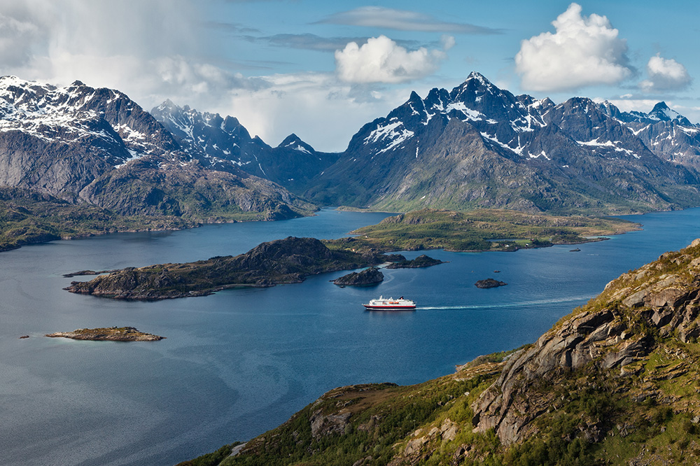 One of Hurtigruten's ships sailing through the Raftsundet in Norway