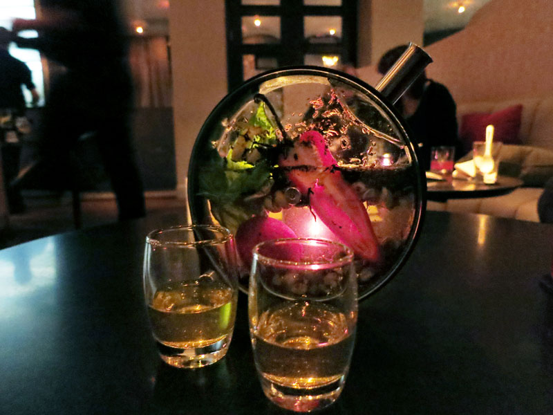 "The ""Heart of Stone"" cocktail served in a porthole at <em>The Aviary </em>- Photo by Hideaway Report editor"