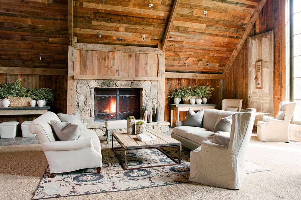 A crackling fire in an inviting living room at Blackberry Farm