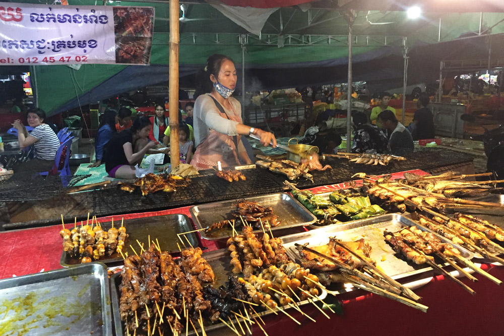 A food vendor selling her wares at the Road 60 night market, part of the Siem Reap Food Tour - Photo by Kristen Remeza