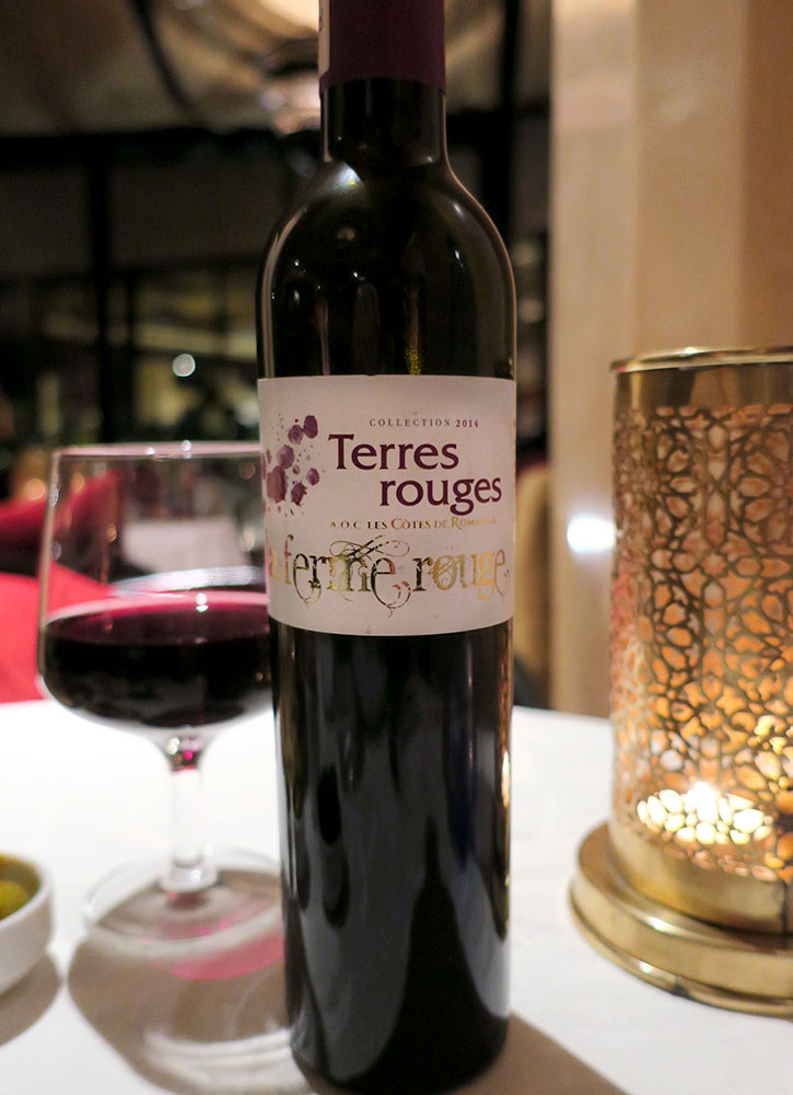 A bottle of La Ferme Rouge's Terres Rouges at Al Fassia in Marrakech