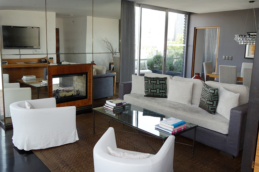 The living room of our Corner Suite at Las Alcobas