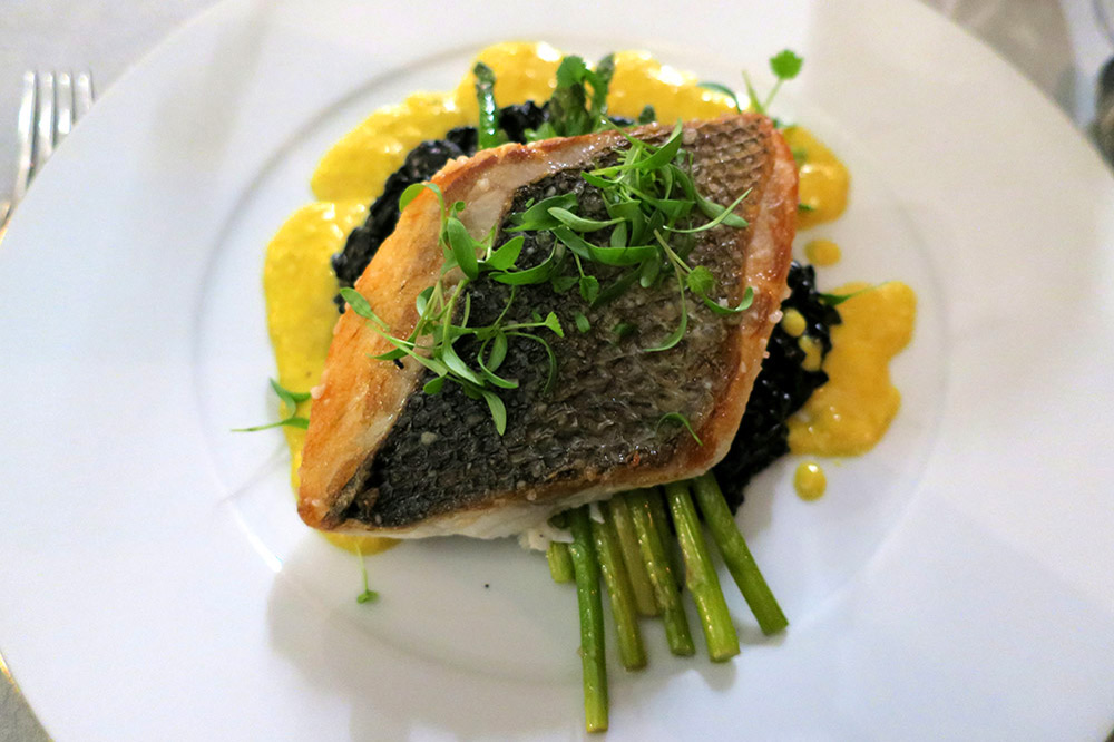 Seabass over squid-ink risotto and baby asparagus with saffron creamentree at <em>Sítio</em> restaurant at the Valverde Hotel