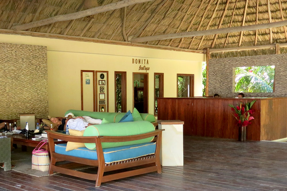 Drunk visitors napping on the sofa by the front desk at El Secreto
