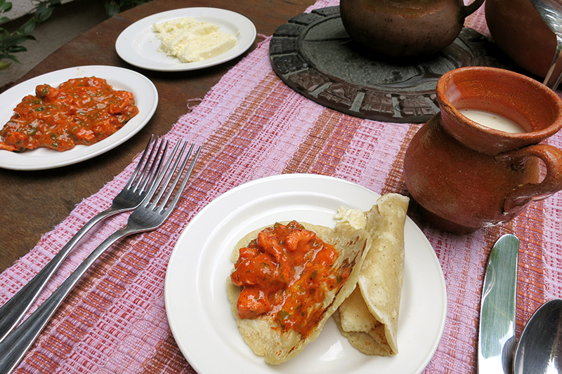 Our homemade meal of tortillas, chicken in a sauce of garlic, tomatoes, cilantro and achiote, and <i>atole</i>, a traditional corn and cinnamon drink, from our cooking class at Ka'ana - Photo by Hideaway Report editor