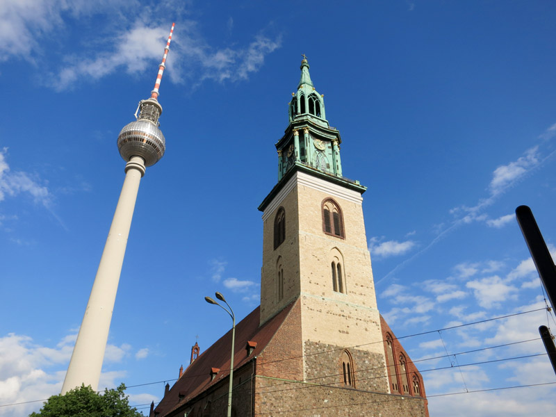 Fernsehturm (Television Tower) and Marienkirche (St. Mary's Church) at Alexanderplatz, the communist showplace of East Berlin - Photo by Hideaway Report editor