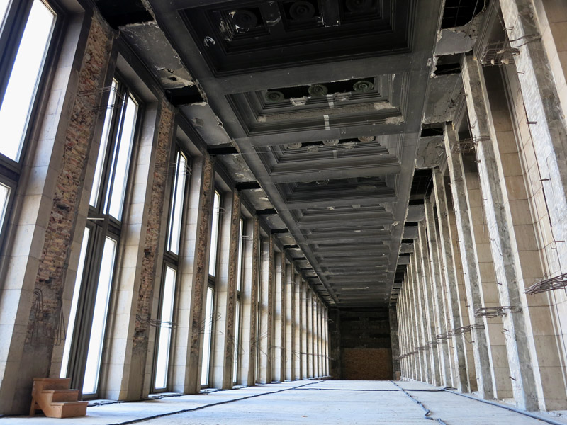 "The vestibule's monumental original ceiling, burned by a fire started during World War II. The ""floor"" below is a postwar dropped ceiling, halving the height of the vestibule - Photo by Hideaway Report editor"