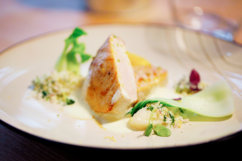 Swordfish fillet with a passion fruit gelée, bok choy and coconut cilantro gremolata in a curry emulsion at Miles
