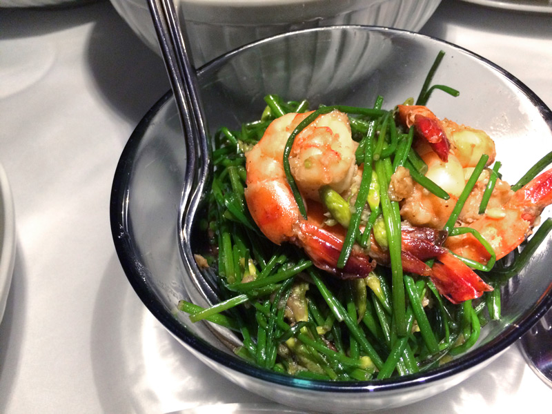 Stir-fried prawns with garlic chives aboard the<i> Aqua Mekong </i> - Photo by Hideaway Report editor