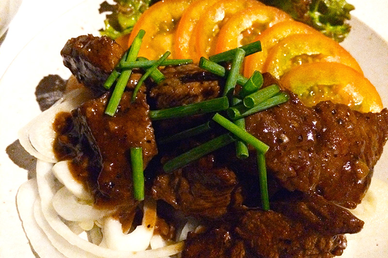 Beef lok lak, part of our Khmer feast at Song Saa -  Photo by Hideaway Report editor