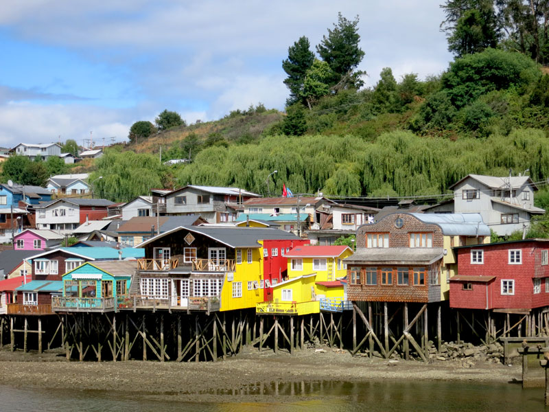 Palafitos, colorful stilt houses built over the water on Chiloé Island
