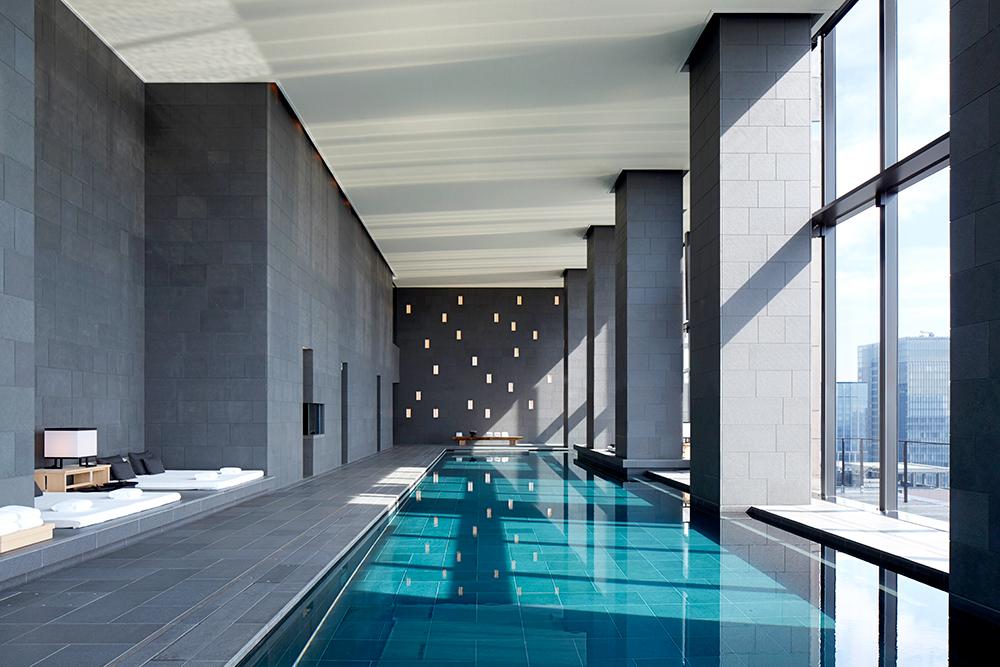 The 98-foot basalt-lined indoor pool at Aman Tokyo