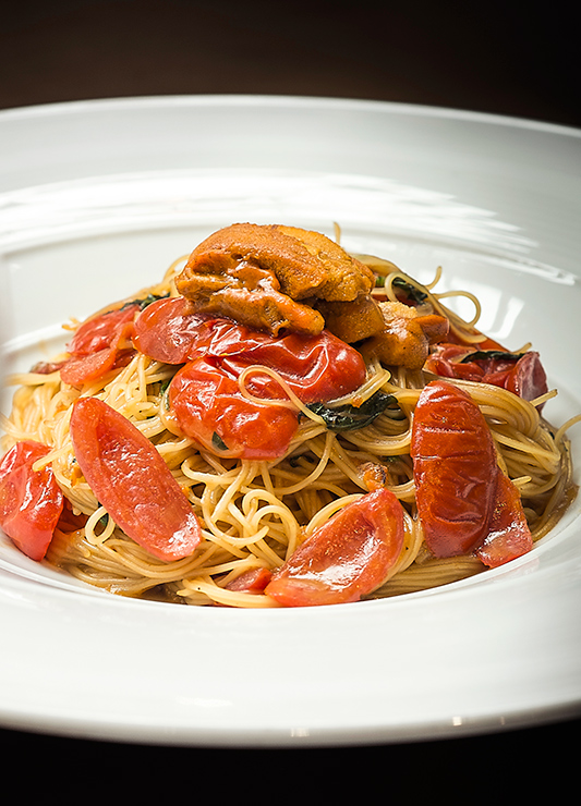 Angel-hair pasta with uni, cherry tomatoes and garlic chips at <i>AMMO</i>