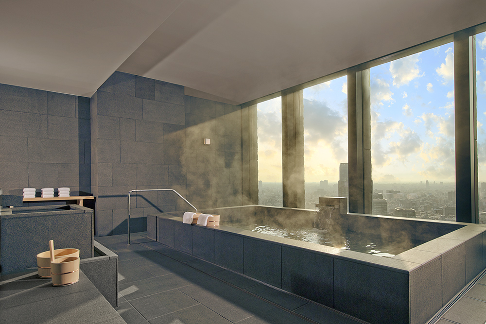 Large onsen (traditional Japanese hot bath) in the spa at Aman Tokyo