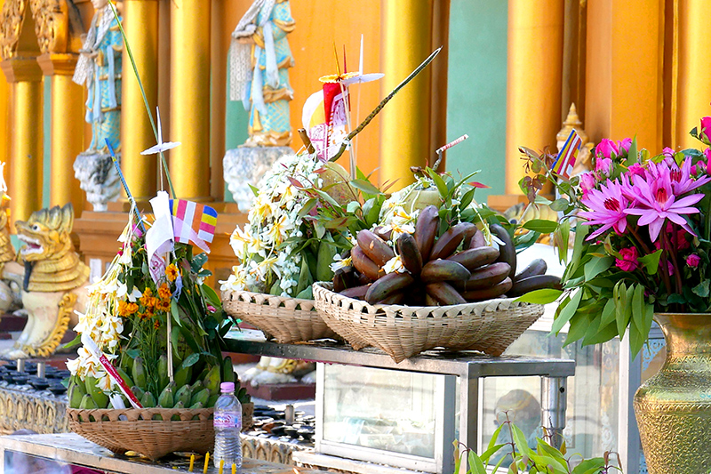 Offerings of food and flowers brought by visitors at the Shwedagon - Photo by Hideaway Report editor